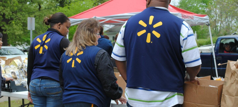 Walmart employees volunteering at Feed More