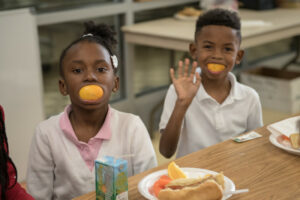 Boy and girl oranges