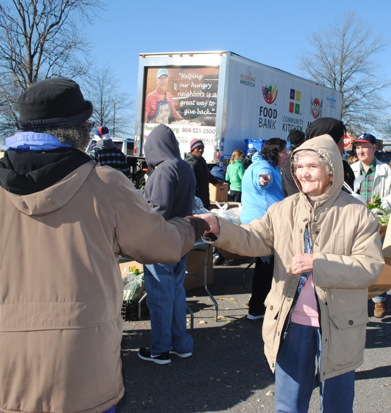 Feed More Mobile Pantry smiling woman
