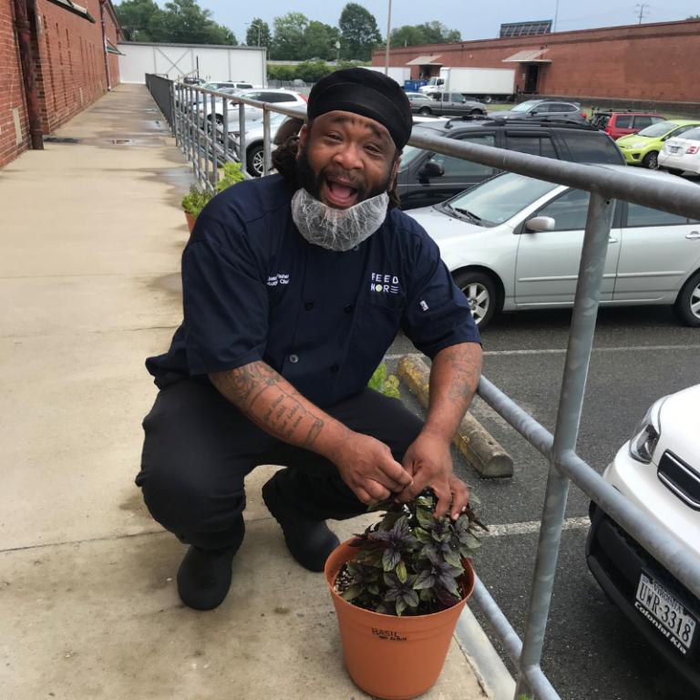 Executive Chef Antjuan Feed More's herb garden