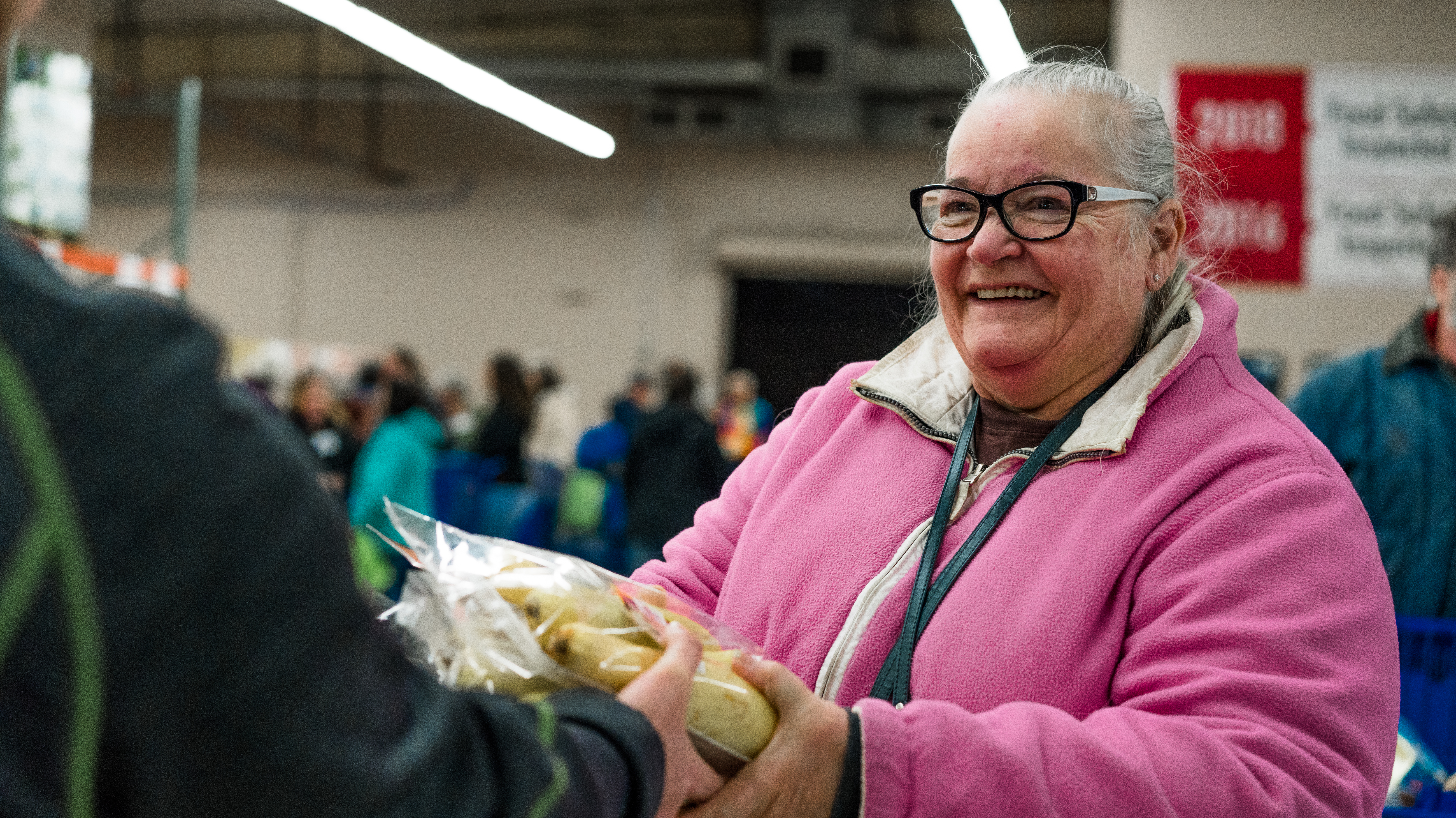 Lady smiling receiving food