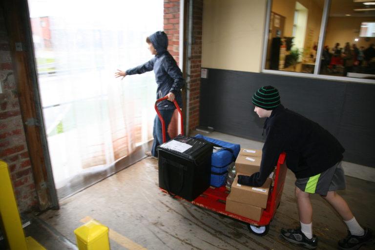 Volunteers loading meals