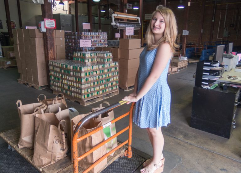 Young girl with food drive donation