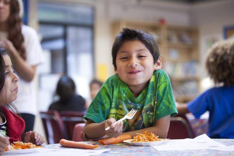 Boy eating carrots