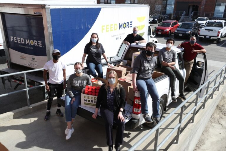 Timmons team on truck with food donation